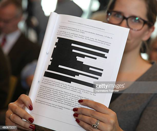 A journalist holds the redacted information to the media at a press conference following the announcement earlier today that Pope Francis has...
