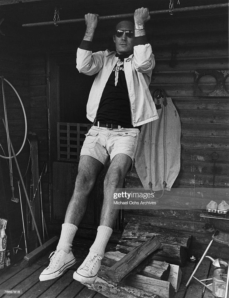 Journalist Hunter S. Thompson does a pull up on his ranch circa 1976 near Aspen Colorado.