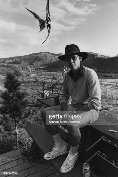 Journalist Hunter S Thompson sits on a table on his ranch circa 1976 near Aspen Colorado