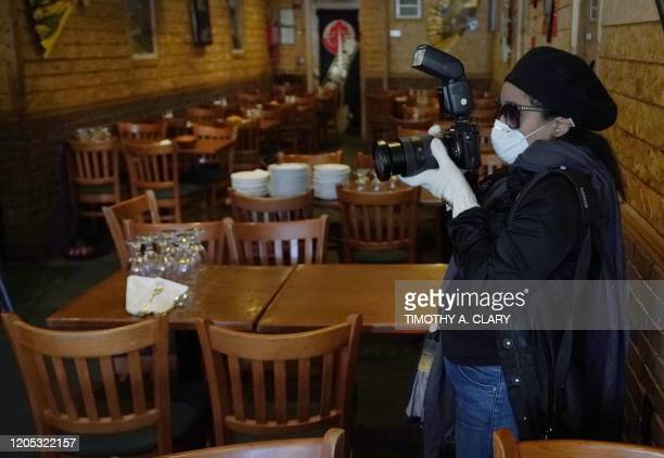 A journalist in a mask waits for the arrival of Westchester County Executive George Latimer and New Rochelle Mayor Noam Bramson for lunch at Eden Wok...