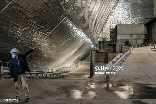 Journalist inside the 'New Safe Confinement' which contains the old sarcophagus entombing the destroyed reactor number four at the Chernobyl Nuclear...