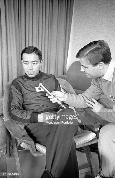 A journalist interviewing Japanese alpine ski racer Chiharu Igaya during the VII Olympic Winter Games Cortina d'Ampezzo 1956
