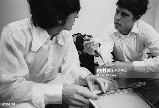 A journalist interviews George Harrison in the VIP lounge at Kaitak Airport Hong Kong as the Beatles wait for a connecting flight to Manila on their...