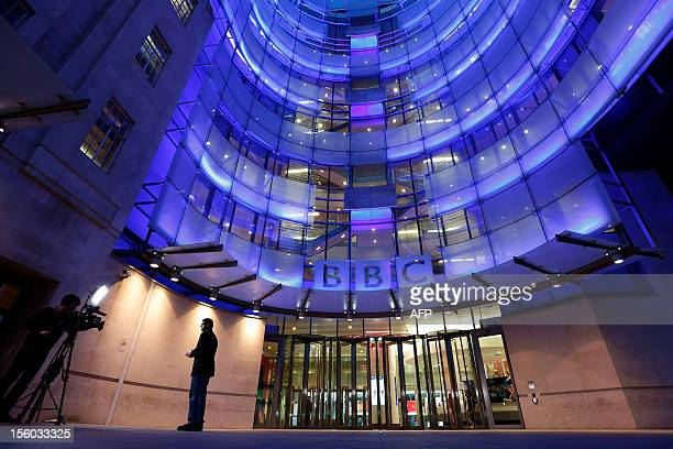 A journalist is seen presenting in front of camera outside the BBC's New Broadcasting House in central London on November 11 2012 The world's largest...