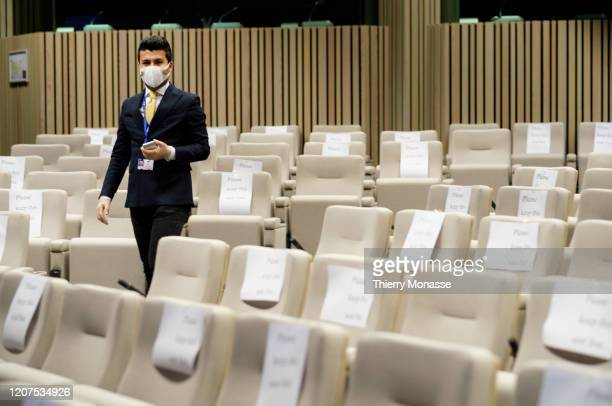 A journalist is wearing a mask and gloves while he waits for the EU Leaders press conference at the European Council building on March 17 2020 in...