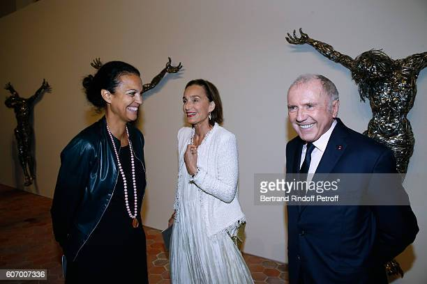 Journalist Isabelle Giordano actress Kristin Scott Thomas and Francois Pinault attend the 4O Rue de Sevres Preview at the Head Offices of Both Kering...