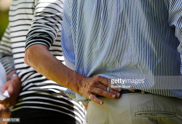 Journalist James Foley's mother Diane slips her finger inside her husband John's belt loop as they speak to reporters about the murder of their son...