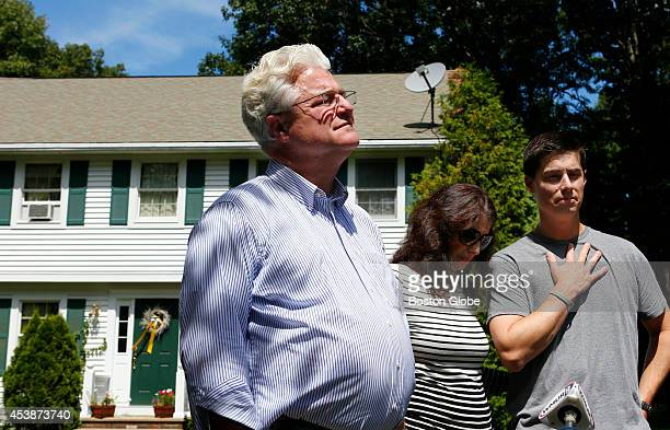 Journalist James Foley's parents John and Diane Foley and his brother Michael speak to reporters about James' murder outside of their home in...