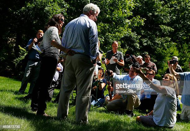 Journalist James Foley's parents John and Diane Foley speak to reporters about James' murder outside of their home in Rochester New Hampshire August...