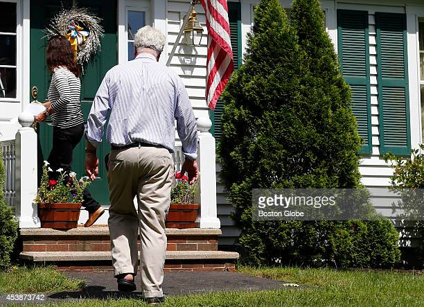 Journalist James Foley's parents John and Diane Foley walk back inside their home after speaking to reporters about James' murder outside of their...