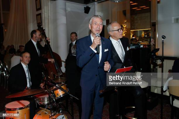 Journalist JeanClaude Narcy and Director of the 'Le Relais Plaza' Restaurant Werner Kuchler sing during 'The Swing in Relais Evening' at 'Le Relais...