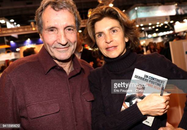 Journalist JeanJacques Bourdin and Reporter Anne Nivat poses during Paris Book Fair 2018 at Parc Des Expositions Porte de Versailles France on