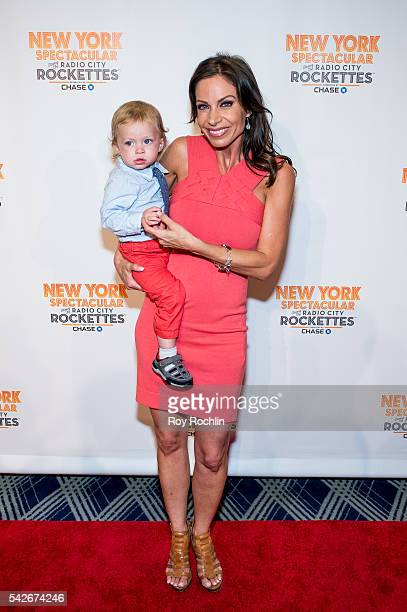 Journalist Jill Nicolini and her son Austin attends the New York Spectacular opening night at Radio City Music Hall on June 23 2016 in New York City