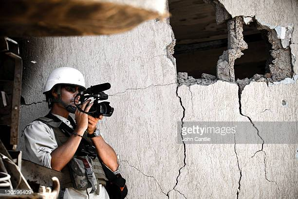 Journalist Jim Foley films Libyan NTC fighters attacking the west side of Colonel Gaddafi's home city of Sirte on October 05 2011 in Libya NTC forces...