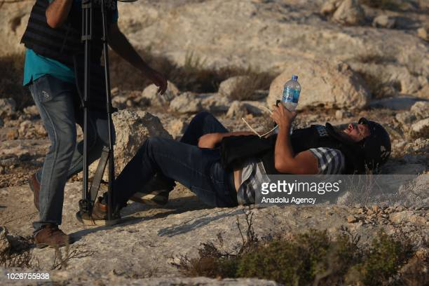 AFP journalist Joe Dyke lies on the floor as he gets injured by the intervention of Israeli forces while covering demonstrations in the village of...