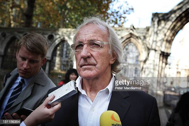 Journalist John Pilger a supporter of WikiLeaks founder Julian Assange talks to reporters outside The High Court on November 2 2011 in London England...
