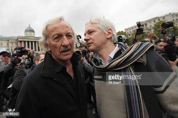 Journalist John Pilger and Julian Assange founder of the WikiLeaks website chat before addressing the crowd during the 'Antiwar Mass Assembly'...