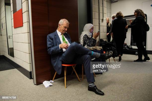 Journalist Jon Snow and Diana Legacy Award winner Maya Ghazal prepare backstage during the Human Flow premiere at Milton Court Concert Hall on...