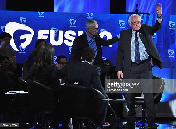 Journalist Jorge Ramos and democratic presidential Bernie Sanders pictured onstage during the FUSION presents the Brown Black Democratic Forum at...