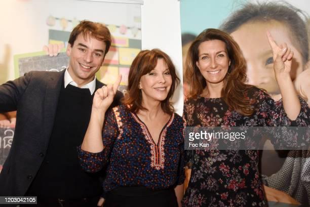 Journalist Julian Bugier Toutes a l'Ecole frounder Tina Kieffer and AnneClaire Coudray attends the Levons Le Doigt Pour L'Education des Filles...