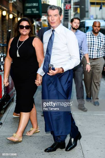 Journalist Keely Shaye Smith and actor Pierce Brosnan enter the The Late Show With Stephen Colbert taping at the Ed Sullivan Theater on September 25...