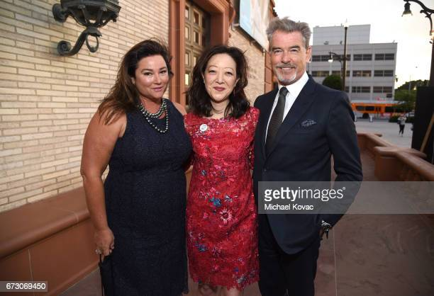 Journalist Keely Shaye Smith President of NRDC Rhea Suh and actor Pierce Brosnan attend NRDC STAND UP for the planet 2017 on April 25 2017 in Beverly...