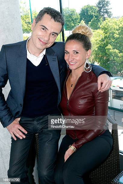 Journalist Laurent Luyat and former tennis player and journalist Tatiana Golovin attend Roland Garros Tennis French Open 2013 Day 10 on June 4 2013...
