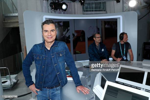 Journalist Laurent Luyat inaugurates the France Television french chanel studio on the Philippe Chatrier Court during the 2019 French Tennis Open -...