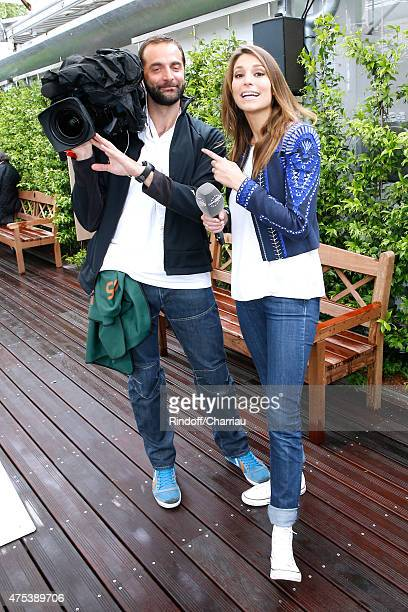 Journalist Laury Thilleman and her Cameraman attend the 2015 Roland Garros French Tennis Open Day Eight on May 31 2015 in Paris France