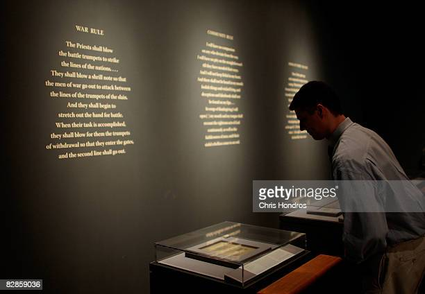 A journalist leans over to look at one of the Dead Sea Scrolls at the The Jewish Museum September 17 2008 in New York City The Dead Sea Scrolls...