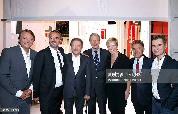 Journalist Lionel Chamoulaud, Journalist Francois Brabant, Presenter of the Show Michel Drucker, Deputy Director General of France Televisions for...
