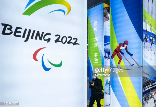 Journalist looks at a display at the exhibition center for the Beijing 2022 Winter Olympics in Yaqing district on February 5, 2021 in Beijing, China....