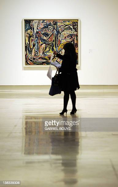 A journalist looks at documents past 'Circumsision' by US artist Jackson Pollock belonging to the Guggenheim foundation as part as an exhibition...