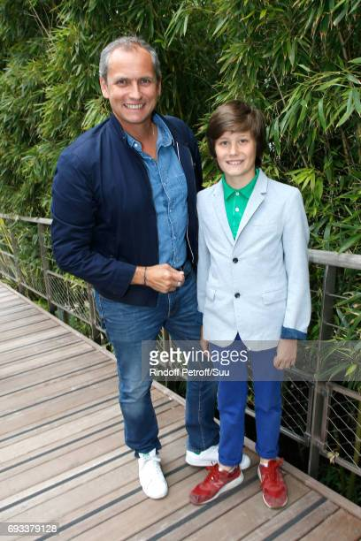 Journalist Louis Laforge and his son Marius attend the 2017 French Tennis Open Day Eleven at Roland Garros on June 7 2017 in Paris France