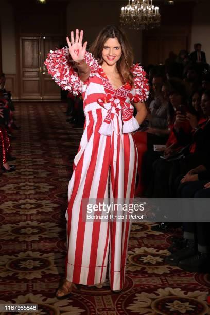 Journalist Margaux de Frouville dressed by Emmanuelle Julliard walks the runway during the 3rd Sauvez Le Coeur Des Femmes Red Defile show at Hotel...