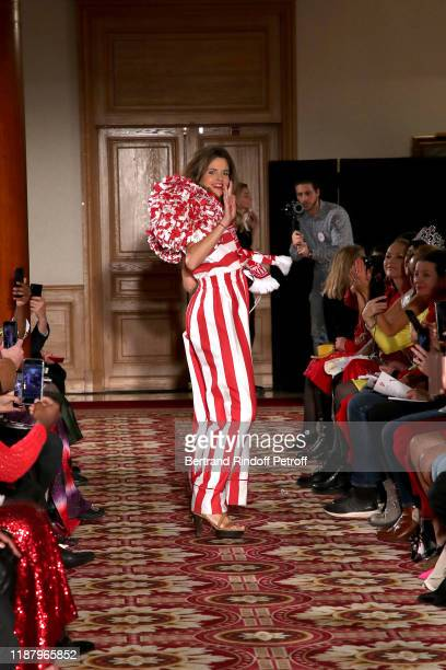 Journalist Margaux de Frouville dressed by Emmanuelle Julliard walks the runway during the 3rd Sauvez Le Coeur Des Femmes Red Defile show at Hotel...