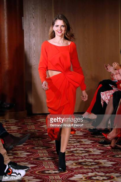 Journalist Margaux de Frouville dressed by Paule Ka walks the runway during the Sauvez le Coeur des Femmes Red Defile Show at Hotel Marriot on...