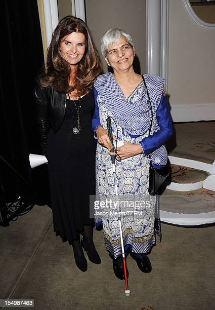 Journalist Maria Shriver and honoree Zubeida Mustafa attend the 2012 Courage in Journalism Awards hosted by the International Women's Media...