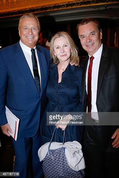 Journalist Marine Jacquemin standing between Christian CourtinClarins and his brother Olivier CourtinClarins attend the 17th Clarins Award for...