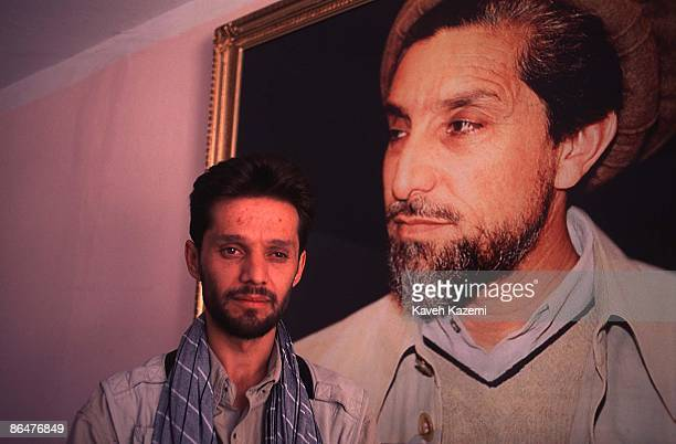 Journalist Mohammad Fahim Dashti poses in front of a portrait of assassinated Afghan commander Ahmad Shah Massoud in his office at the 'Kabul Weekly'...