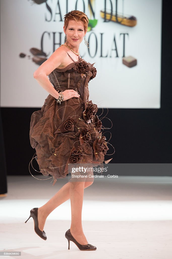 Journalist Natacha Polony walks the runway and wears 'Nymphe des Temps Modernes' a chocolate dress made by designer Christophe Guillarme and Emmanuel Ryon for Cacao Barry during the Fashion Chocolate Show at Salon du Chocolat at Porte de Versailles, in Paris.