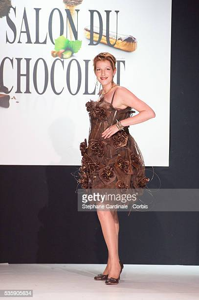 Journalist Natacha Polony walks the runway and wears 'Nymphe des Temps Modernes' a chocolate dress made by designer Christophe Guillarme and Emmanuel...