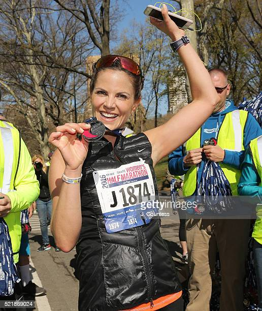 Journalist Natalie Morales holds up her medal after completing the 13th Annual MORE/SHAPE Women's HalfMarathon at Central Park on April 17 2016 in...