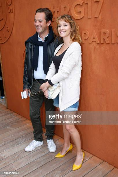 Journalist Nathanael de Rincquesen and Julia Livage attend the 2017 French Tennis Open Day Three at Roland Garros on May 30 2017 in Paris France