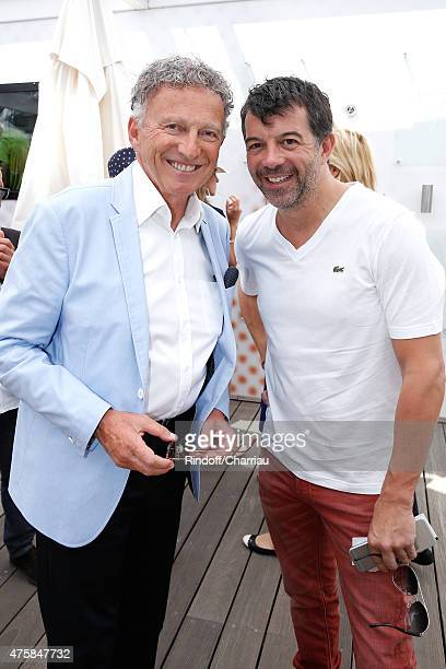 Journalist Nelson Monfort and TV Host Stephane Plaza attend the 2015 Roland Garros French Tennis Open - Day Twelve, on June 4, 2015 in Paris, France.