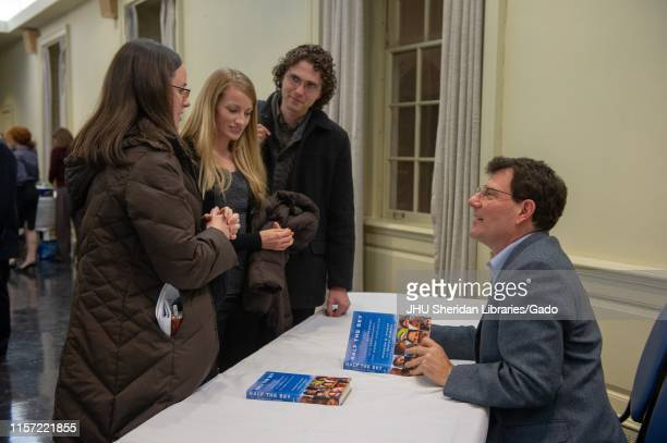 Journalist Nicholas Kristof speaks with students during a Foreign Affairs symposium at the Johns Hopkins University in Baltimore, Maryland, February...