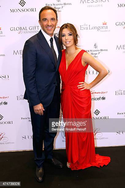 Journalist Nikos Aliagas and Eva Longoria attend the Global Gift Gala Photocall Held at Four Seasons Hotel George V on May 25 2015 in Paris France