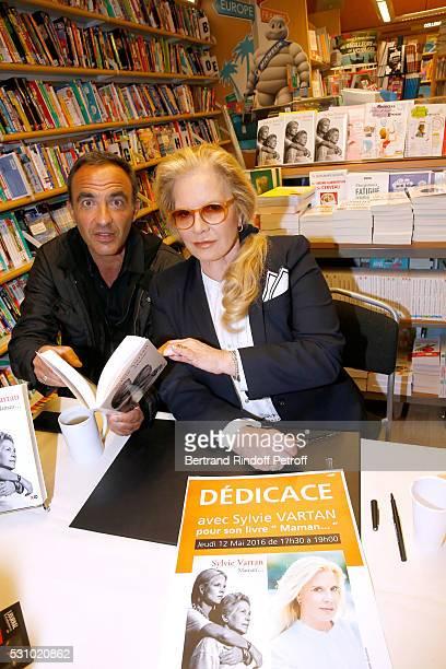 Journalist Nikos Aliagas and singer Sylvie Vartan attend Sylvie Vartan signs her Book 'Maman...' at Librairie Lamartine on May 12, 2016 in Paris,...
