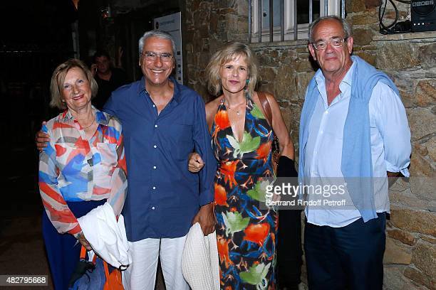 Journalist Norbert Balit and his wife Journalist Laurence Piquet standing between President of Amaury Group MarieOdile Amaury and Guest attend the...