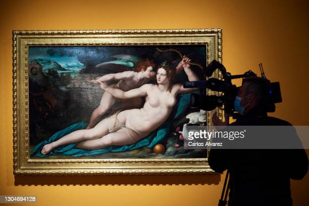Journalist observes Alessandro Allori painting 'Venus and Cupid' belonging to the exhibition 'Mythological Passions' at the Prado Museum on March 01,...